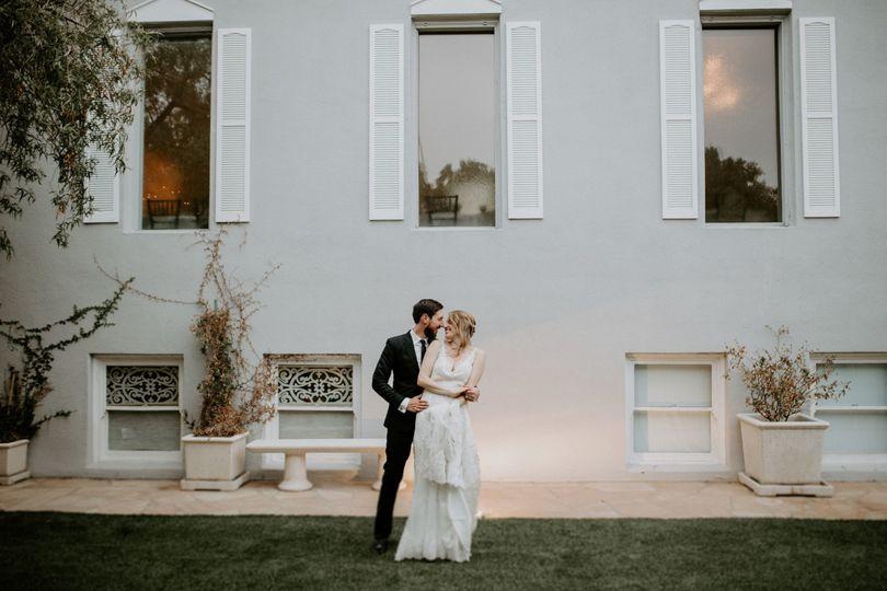 Bride & groom dancing outside