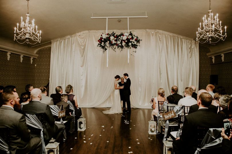 Indoor ceremony with hanging florals