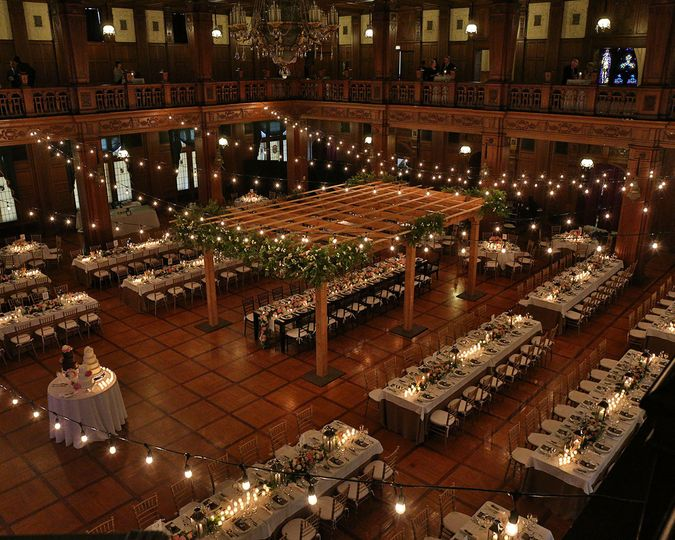 We love how our client transformed the Ballroom with the lights and structure over the king's table!