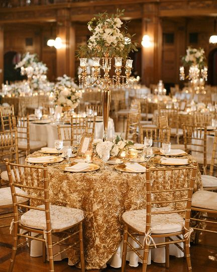 These gold Chiavari chairs are included in Ballroom rentals!*