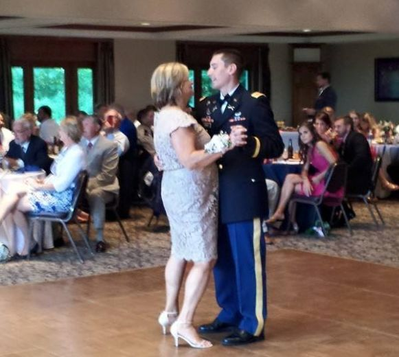 Groom with his mom dancing