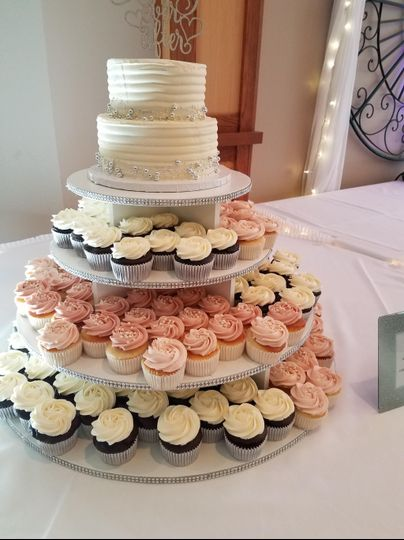 Full display cake and cupcakes