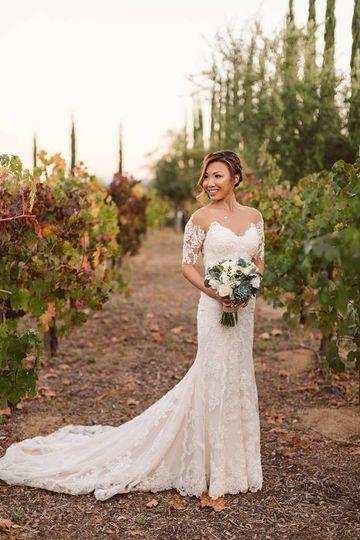 Bride along a vineyard