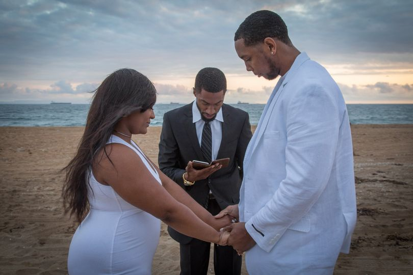 A moment of thankful prayer during a vow renewal on the beach. They had a decade together and were...