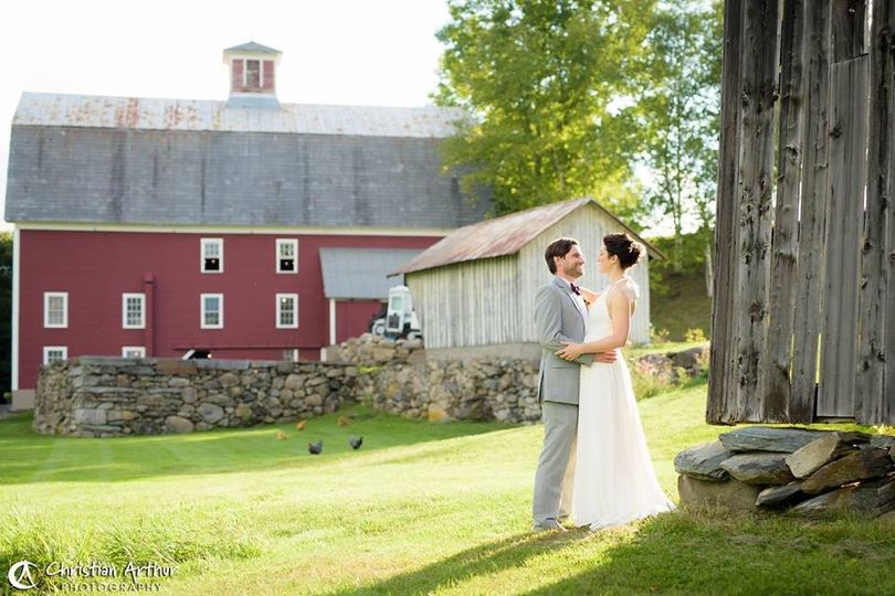 Newlyweds outside the barn