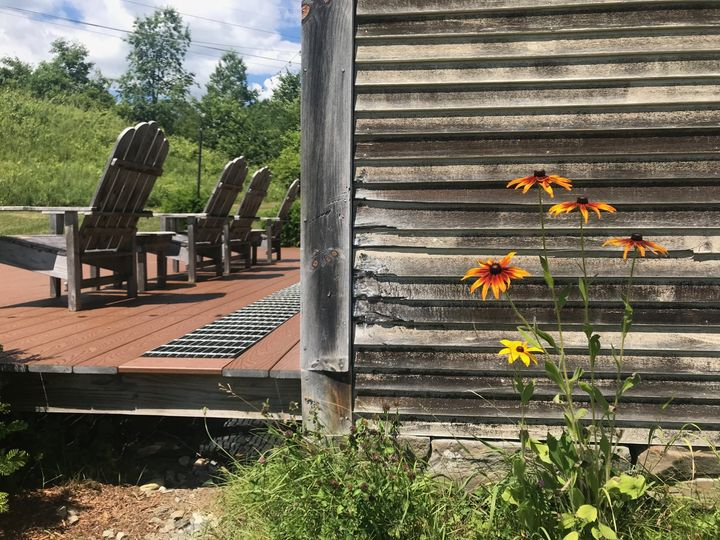 White barn and deck
