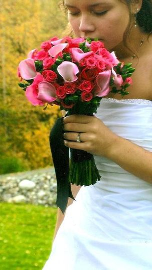 Callas and baby roses in the hottest color of the season!!  Elegant black ribbon wrap to compliment...