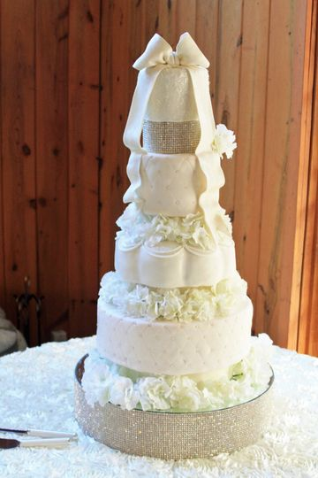 Beautiful all white wedding cake with crystal stand and spacer.