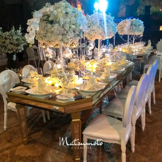 Gold mirror table with orchids