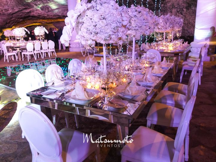 Mirror centerpiece with orchid