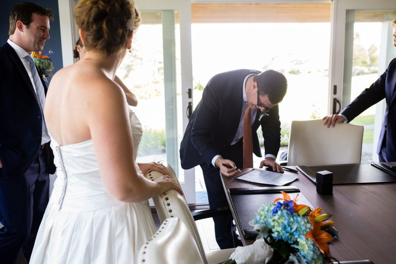 Signing the marriage documents. Photo by Kate Crabtree Photography.