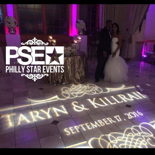 Custom designed monogram projection over the dance floor at talamore country club, pa.
