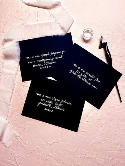 Dark envelope with white ink