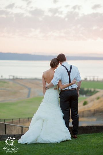 Newlyweds overlooking the field and sea