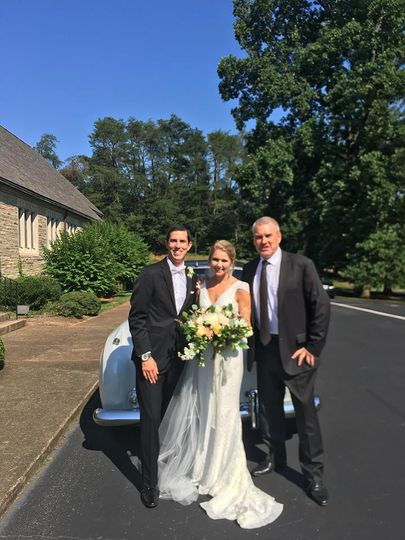 The newlyweds with the chauffeur