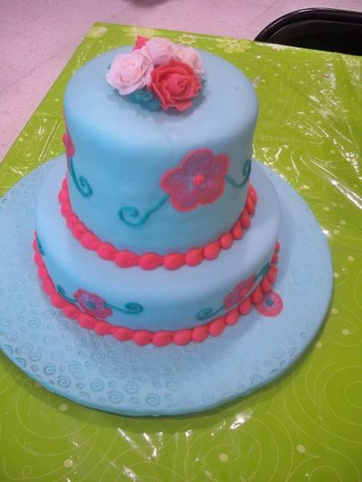 A two tier wedding cake cover in marshmallows fondant.