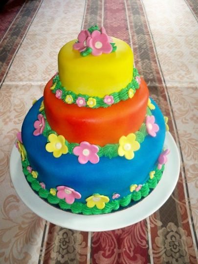 A three tier celebration, birthday, anniversary or wedding cake cover in marshmallow fondant.