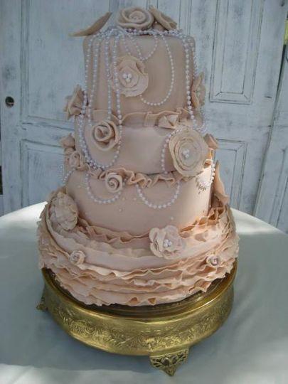Detailed pink wedding cake