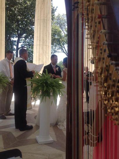 Playing harp at a wedding