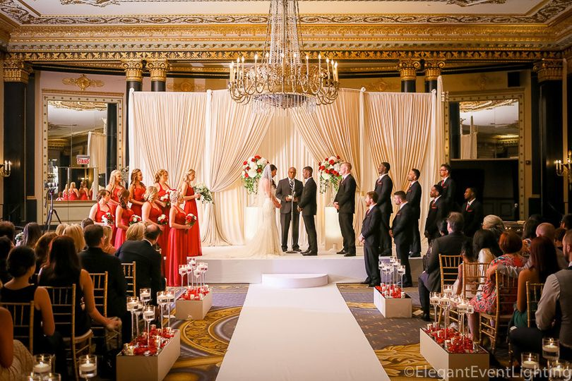 Ivory & champagne backdrop, white stage cover, moon steps, & aisle runner