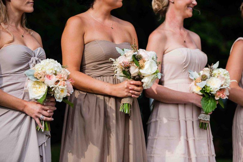 Bridesmaid bouquets of White Scabiosa, Juliet Garden Roses, White Hydrangea, Dusty Miller, Yarrow,...