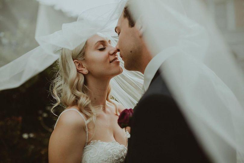 Couple underneath the bride's veil