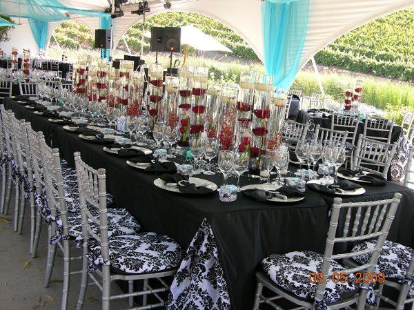 Custom linen with our chiavarri chairs, custom linen. Tiffany blue organza draping and a splash of...