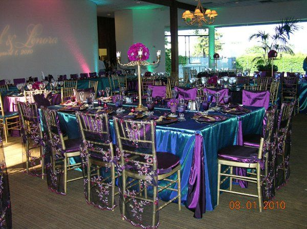 Peacock color was the perfect setting. Custom chair cover on selected tables (banquet tables) was...