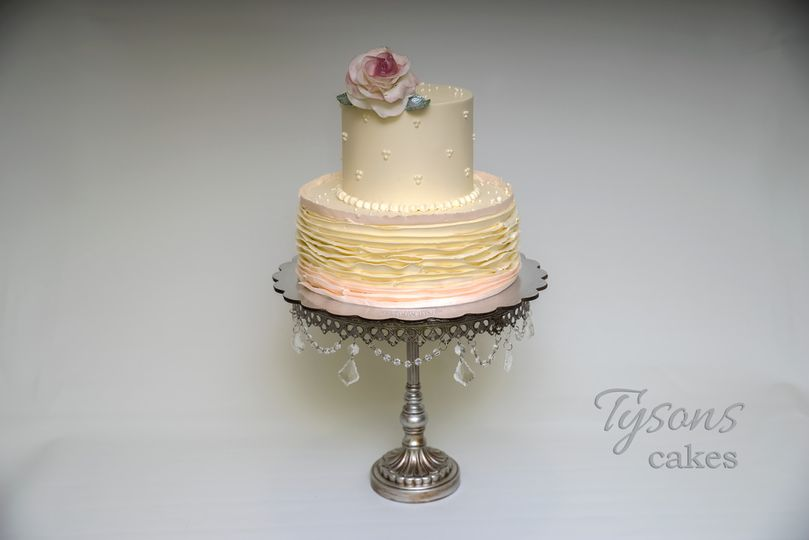 Two tier cake with a flower on top