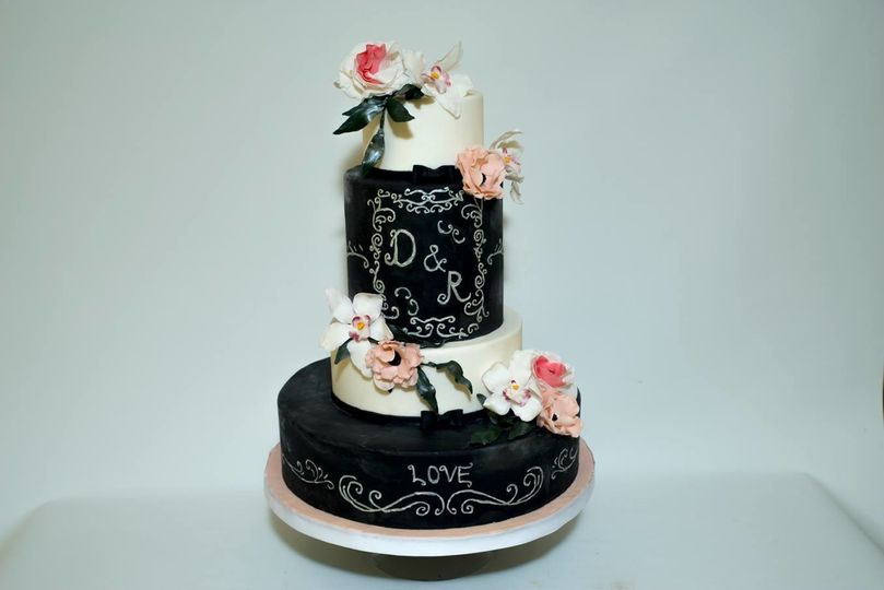 Four tier black and white cake