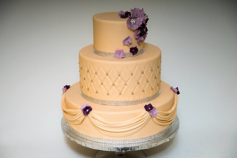 Three tier purple and peach cake