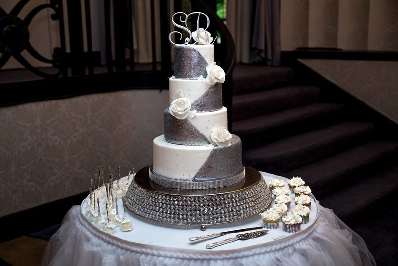 Four tier white and grey cake