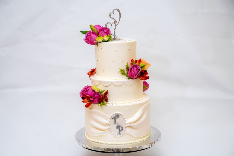 Three tier wedding cake with hearts on top