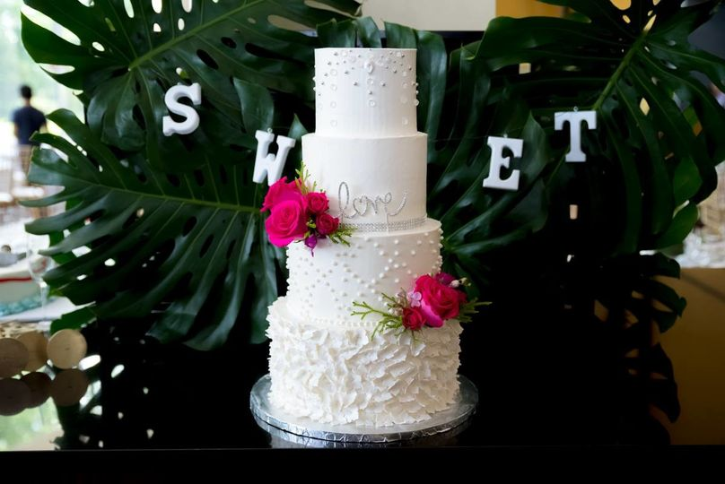 Four tier cake with pink flowers