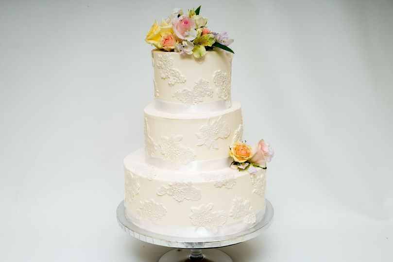 Three tier cake with flowers on top
