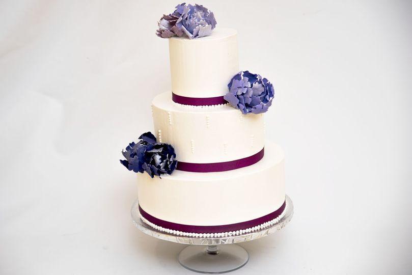 Three tier cake with purple lining