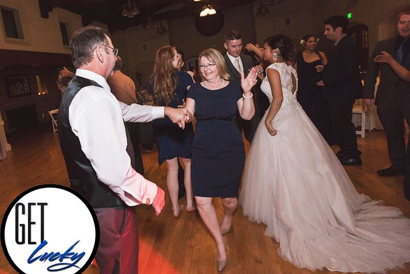 Couples and guests dancing