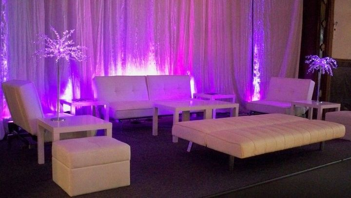 A lounge area with uplighting