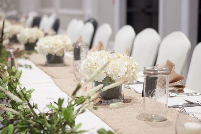 Floral centerpieces and beige table runner