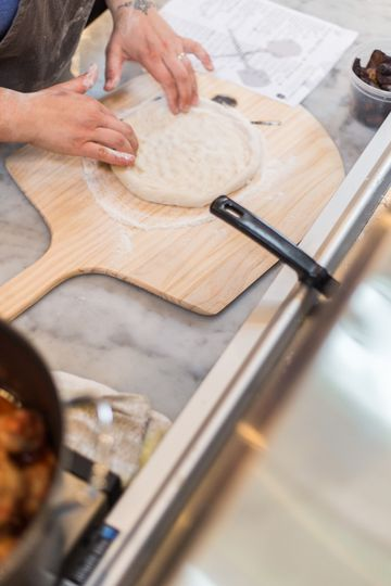 Hand rolled pizza dough