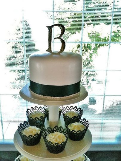 "Cupcake tower wedding cake with 6"" topper cake for the cake cutting ceremony"
