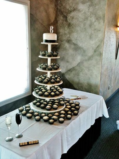 "Cupcake tower wedding cake with 6"" topper cake for the cake cutting ceremony."