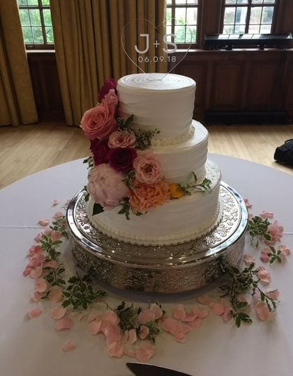 Three tier cake with ascending flowers