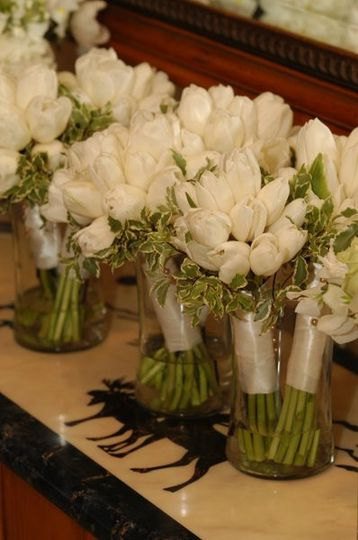Fresh french tulips wrapped in white satin. Photography: Chris Nolls Photography