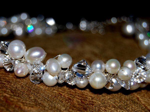 A stunning handmade choker that will sparkle with your every move. Substantial pearls and Swarovski...