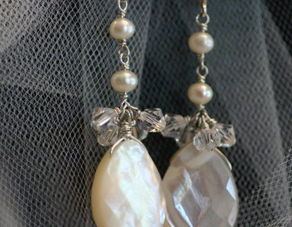 Large mother of pearl teardrops are highlighted with Swarovski and delicate pearls. All wire...