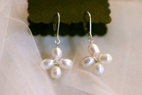 For the bride who wants a minimal, yet unique accessory, four pearls are wire wrapped in sterling to...