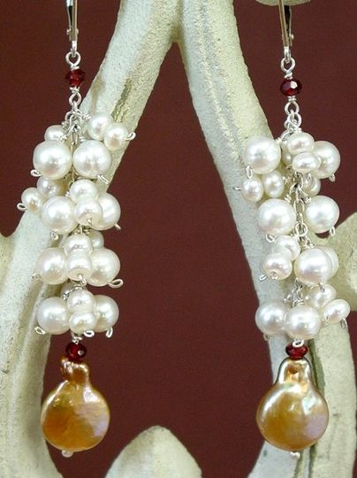 Bronze coin pearls are accented with tiny garnets and a beautiful flow of pearls. Look closely to...