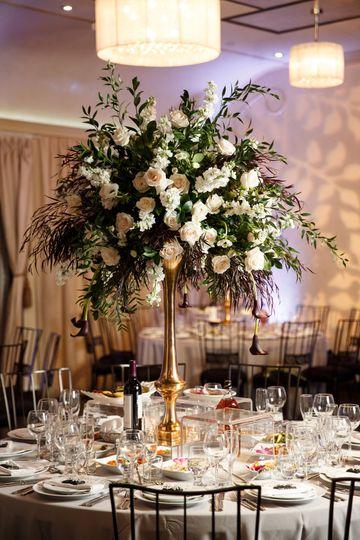 Centerpiece by Avant Garden at Anita & Arby's NOOR | Sofia Ballroom Wedding. Photo Credit: Rene...
