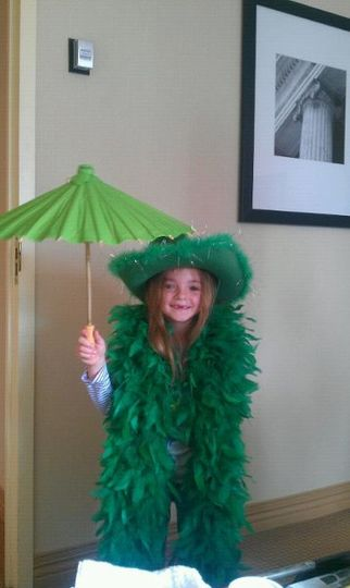 The Flower Girl playing with some St. Patty's Day props (before she was dressed for the day)...